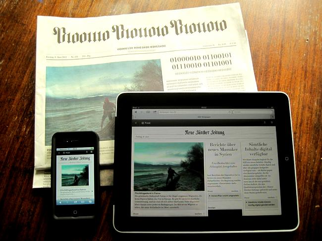newspaper, tablet, phone